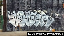 Graffiti is shown on a Vietnam War memorial in the Venice area of Los Angeles, May 27, 2016. The memorial lists the names of American service members missing in action or unaccounted for in Southeast Asia, painted by a Vietnam veteran and dedicated in 199