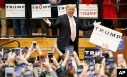 Republican presidential candidate Donald Trump gestures during a rally at Radford University in Radford, Va., Feb. 29, 2016.