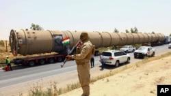 De nouvelles équipements arrivent à la raffinerie de Kalak, Irak, le 14 juillet 2014.