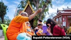 Monks from Wat Thai Los Angeles, offer blessings to visitor to the temple in Los Angeles, CA. Sunday, April 11, 2021, during the Songkran, Thai New Year Ceremony