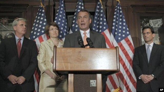 House Speaker John Boehner of Ohio, at podium, accompanied by members of the House Republican leadership, speaks during a news conference at The Republican National Committee on Capitol Hill in Washington, July 26, 2011