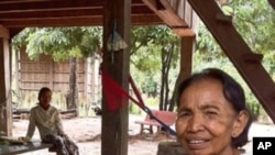 Im Chaem, a former Khmer Rouge commander, holds her grandson at her home in Anlong Veng district, in Cambodia's Oddar Meanchey province, where she is a first deputy commune chief.