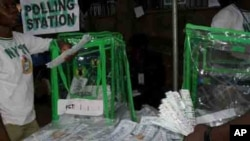 Preparing to start counting votes at a polling station in Abuja, Nigeria's capital