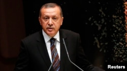FILE - Tayyip Erdogan addresses members of his ruling AK Party during a meeting at the party headquarters in Ankara, Turkey, Aug. 14, 2014.