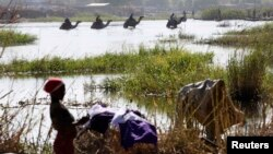 FILE - Nigerians fleeing Boko Haram attacks continue to enter Chad, at Lake Chad at Ngouboua.