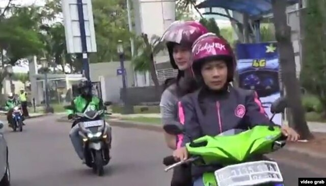FILE - Indonesian service LadyJek provides a transportation alternative for women who feel more comfortable being driven by female bikers.