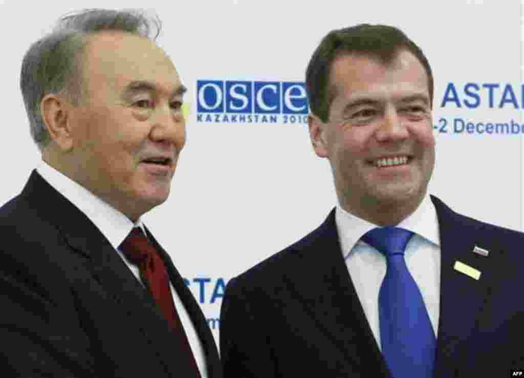 Russian President Dmitry Medvedev, right, and Kazakh President Nursultan Nazarbayev seen at the start of OSCE (Organisation for Security and Cooperation in Europe) meeting in Astana, Kazakhstan's capital, on Wednesday, Dec. 1, 2010. The group uniting th