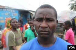 Robert Sayon, who lives in West Point, says many live in fear of contracting ebola which impacts an already stressful life in one of Monrovia's poorest districts, Monrovia, Liberia, Sept. 25, 2014. (Benno Muchler /VOA)