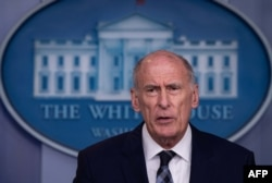 FILE - U.S. Director of National Intelligence Dan Coats speaks during a press briefing at the White House, Aug. 2, 2018.