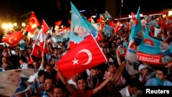 Supporters of Turkey's Prime Minister Recep Tayyip Erdogan celebrate his election victory in front of his party's headquarters in Ankara August 10, 2014.