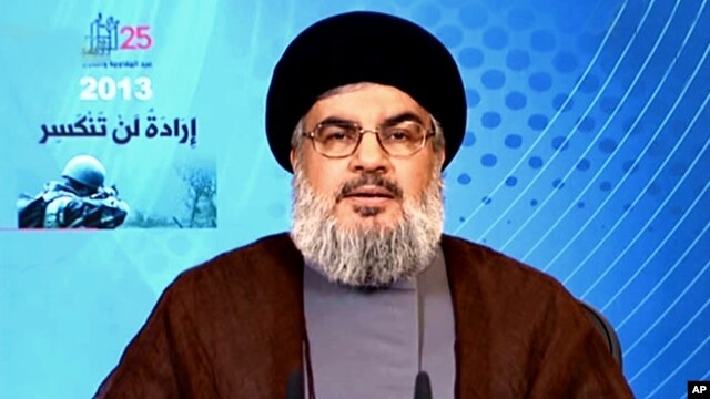 In this photo released by the Syrian official news agency SANA, Hezbollah chief Hassan Nasrallah, gives a televised speech from an unknown location, May 25, 2013