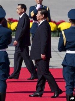 习近平和李克强在十一国庆庆典上 (图片来源:AP)