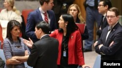 U.S. Ambassador to the United Nations Nikki Haley (L) speaks with Chinese Deputy Ambassador to the United Nations Wu Haitao (R) ahead of the United Nations Security Council session on imposing new sanctions on North Korea. (REUTERS/Amr Alfiky)