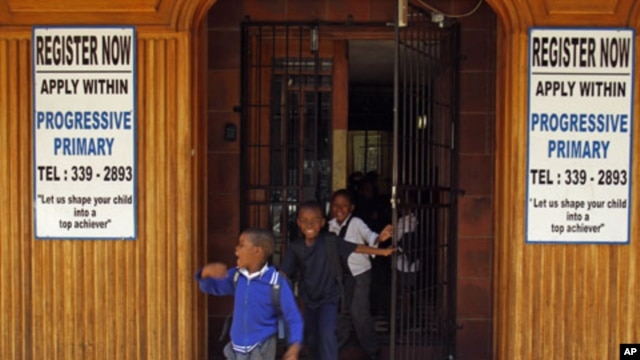 Students run out of the main door as they leave the Progressive Primary in Johannesburg (2010 file photo). Progressive Primary is among an increasing number of such schools for poor South Africans underserved by a government that has struggled to close th