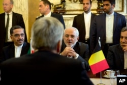 Iranian Foreign Minister Mohammad Javad Zarif, center right, speaks with Belgian Foreign Minister Didier Reynders during a meeting at the Egmont Palace in Brussels, Jan. 11, 2018. European Union foreign ministers held separate talks with their Iranian counterpart in Brussels amid doubts over the future of an international agreement curbing the Islamic Republic's nuclear ambitions.