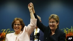 Beth Asaro, left, and Joanne Schailey celebrate after exchanging vows to become the first same-sex couple married in Lambertville, N.J. history at 12:01 a.m. Monday, Oct. 21, 2013.