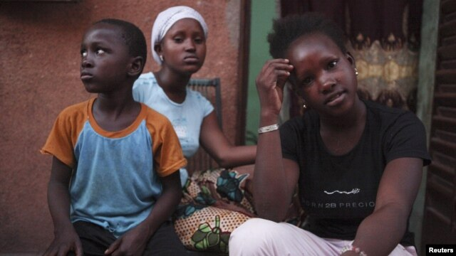 Refugees from the Malian town of Gao, which is now under the control of Islamist forces, pose at a private accommodation in the capital Bamako,  September 8, 2012.
