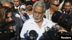 FILE- East Timor Prime Minister Xanana Gusmao speaks to reporters after voting in a polling station during parliamentary elections in Dili, July 7, 2012.