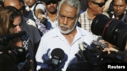 East Timor Prime Minister Xanana Gusmao speaks to reporters after voting in a polling station during parliamentary elections in Dili, July 7, 2012.