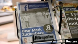 The front page of Norway's Aftenposten is seen at a news stand in Oslo, Norway, Sept. 9, 2016. The newspaper's chief editor accused Facebook of abusing its power after it deleted an 1972 iconic image of a nude Vietnamese girl running from a napalm attack.