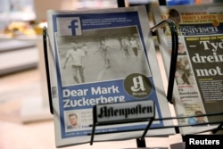FILE - The front page of Norway's Aftenposten is seen at a newsstand in Oslo, Norway, Sept. 9, 2016. The newspaper's chief editor accused Facebook of abusing its power after it deleted an 1972 iconic image of a nude Vietnamese girl running from a napalm attack.