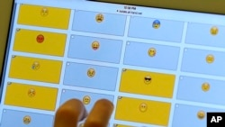 FILE - In this Feb. 15, 2016 photo, a student demonstrates how emojis are used during a research session on the Kansas State University campus in Olathe, Kan.