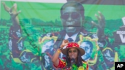 FILE - Zimbabwe's first lady Grace Mugabe greets supporters at a rally in Lupane about 170 Kilometres north of Bulawayo, Zimbabwe, July 21, 2017.