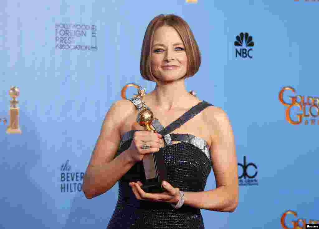 Actress Jodie Foster poses with her Cecil B. DeMille award at the 70th annual Golden Globe Awards in Beverly Hills, California January 13, 2013.