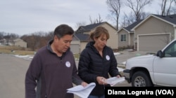 Joe Enriquez Henry with the League of United Latin American Citizens goes door-to-door to urge people to vote in Des Moines, Iowa. Iowa's first-in-the-nation caucuses kick off the U.S. primary election season Monday.