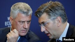 Hashim Thaci, president of Kosovo, left, talks with Andrej Plenkovic, prime minister of Croatia, during a news conference after the Strategic Dialogue of the Western Balkans meeting at the World Economic Forum in Cologny, near Geneva, Switzerland, Oct. 2, 2018.
