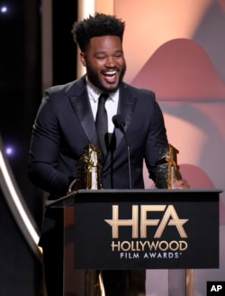 """Director Ryan Coogler accepts the Hollywood film award for """"Black Panther"""" at the Hollywood Film Awards on Nov. 4, 2018, at the Beverly Hilton Hotel in Beverly Hills, California."""