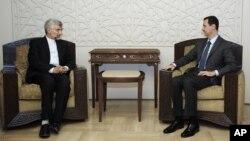 Bí thư Hội đồng An ninh Quốc gia Iran Saeed Jalili gặp Tổng thống Syria Bashar al-Assad tại Damascus, ngày 7/8/2012