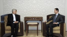 Iran's Supreme National Security Council, Saeed Jalili, meets with Syrian President Bashar Assad in Damascus, Syria, Aug. 7, 2012.  (SANA)