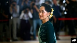 FILE - In this March 15, 2016 file photo, National League for Democracy party (NLD) leader Aung San Suu Kyi arrives in Manama's parliament in Naypyitaw, Myanmar.