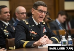 FILE - U.S. Army General Joseph Votel, commander of the U.S. Central Command, testifies during a House Armed Services Committee hearing on Capitol Hill in Washington, Feb. 27, 2018.
