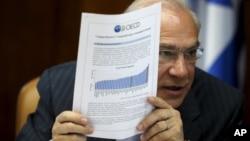 La OCDE, dirigida por Ángel Gurria, dice que la lenta recuperación de la crisis económica global y el lento progreso en las reformas económicas están dificultando el progreso.