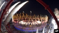FILE - Fireworks ignite over Olympic Stadium during opening ceremonies of the 2012 Summer Olympics in London, July 28, 2012.