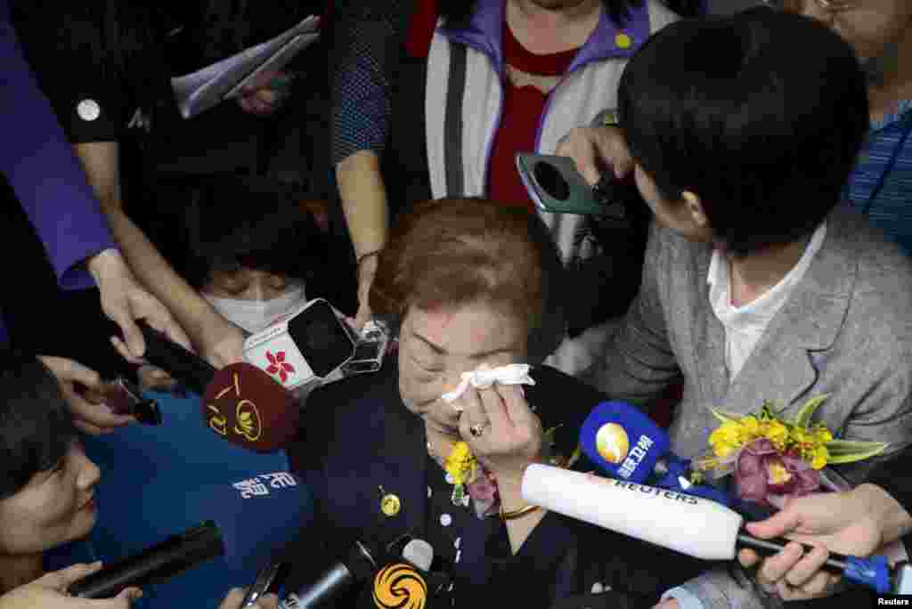 "Former comfort woman Chen Lien-hua, center, wipes tears as she talks to media during a ceremony unveiling the nameplate of a museum dedicated to Taiwan's ""comfort women"" on International Women's Day, in Taipei, Taiwan, March 8, 2016."