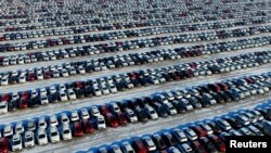 New cars are seen at a parking lot in Shenyang, Liaoning province, China, Jan. 16, 2017.
