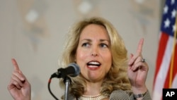 FILE - Former CIA officer Valerie Plame Wilson speaks at an event in Chicago, May 9, 2008.