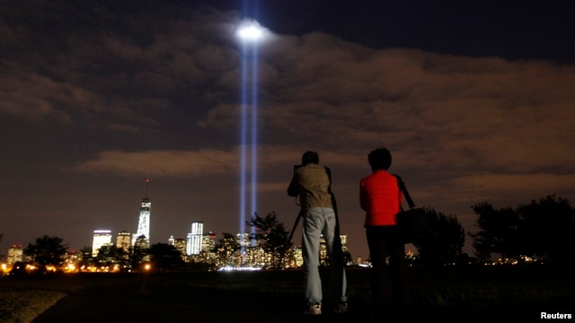 Annual Tribute in Light tested in New York's Lower Manhattan as a man takes a picture at Liberty State Park in Jersey City, New Jersey, September 9, 2013.