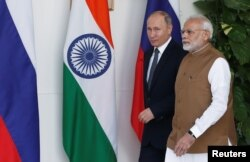 Russian President Vladimir Putin and India's Prime Minister Narendra Modi arrive ahead of their meeting at Hyderabad House in New Delhi, India, Oct. 5, 2018.