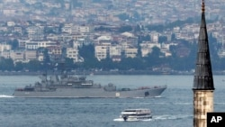 FILE - A Russian warship passes through the Bosphorus, in Istanbul, en route to the Mediterranean Sea, Oct. 6, 2015.