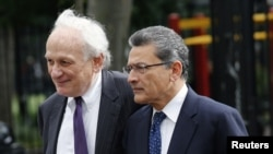 Former Goldman Sachs Group Inc. board member Rajat Gupta, right, and lawyer Gary Naftalis arrive at Manhattan Federal Court in New York, June 14, 2012.