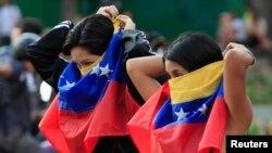 Para demonstran anti-pemerintah dalam protes di Caracas, Venezuela (14/3). (Reuters/Tomas Bravo)