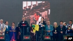 Pro-Kurdish politicians Sirri Sureyya Onder (3rd L) and Pervin Buldan (6th R) read the statement of jailed Kurdish rebel leader Abdullah Ocalan in the southeastern Turkish city of Diyarbakir March 21, 2013.
