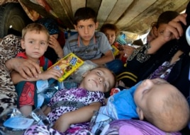 Refugees arrive at Sulaimaniya province, Iraq, Aug. 8, 2014.
