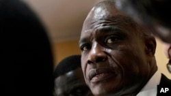 Congolese opposition presidential candidate Martin Fayulu delivers a statement at his headquarters in Kinshasa, Congo, Tuesday Jan. 8, 2019.