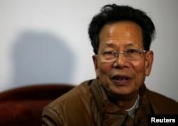 Lin Zuluan, chief in Wukan village, is shown in 2014.