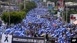Tens of thousands march against Nicaragua's President Daniel Ortega in Managua, Nicaragua, Wednesday, May 30, 2018.